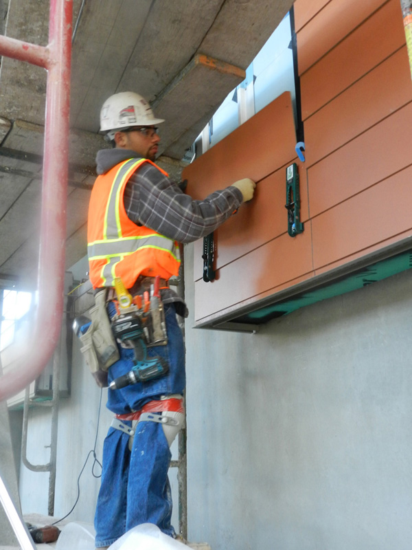Carpenters are installing pre-fabricated siding panels for the exterior skin  on the new affordable housing complex being built with all union labor near downtown Oakland. Nibbi Brothers is the General Contractor for the 6th and Oak Senior Homes project being built by Affordable Housing Associates.