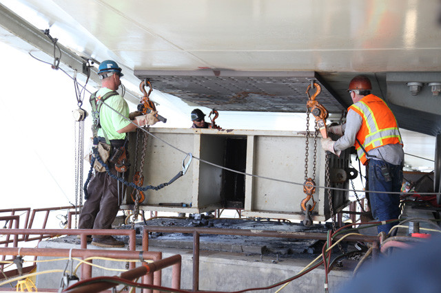 Construction crews continued working on the steel saddle retrofit below the roadway September 4, seen here removing temporary bearings north of the E2 shearkey. Photo courtesy of Caltrans